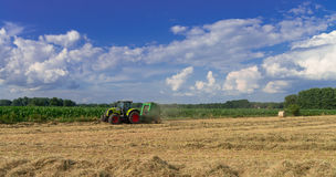 Tractors and harvesting Royalty Free Stock Photo