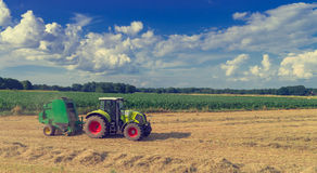Tractors and harvesting - vintage Royalty Free Stock Photo