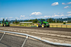 Tractors on horse race track Stock Photo