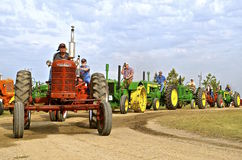 Tractors line up for parade at a Steam Threshers Reunion Royalty Free Stock Images