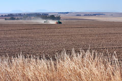 Tractors planting wheat Stock Images