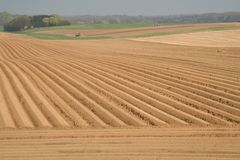 Tractors plough the fields. Belgium. Stock Photos