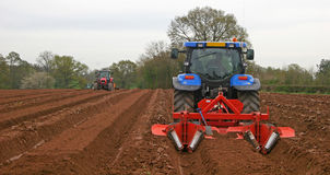 Tractors ploughing Stock Images