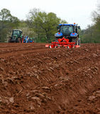 Tractors ploughing Stock Photography