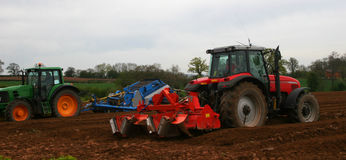 Tractors ploughing Royalty Free Stock Photography