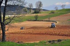 Tractors plowing Stock Photo