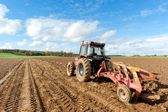 Tractors Plowing Field Royalty Free Stock Image