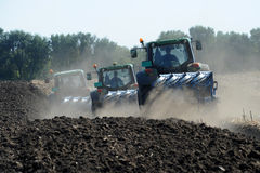 Tractors plowing Stock Image