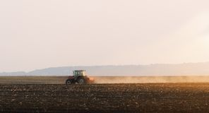 Tractors plowing stubble fields royalty free stock photo