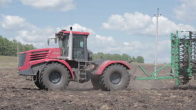 Tractors preparing land for sowing stock video footage