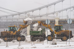 Tractors remove snow from Moscow Gorky Park Royalty Free Stock Images