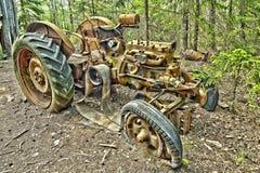 Tractors. Scrap tractors  in the woods Royalty Free Stock Photos