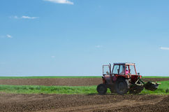 Tractors sowing on agricultural fields on beautiful sunny spring Royalty Free Stock Photo
