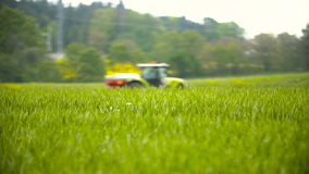 Tractors sprayed with fertilizer. Tractors scatters fertilizer on the wheat field stock video footage