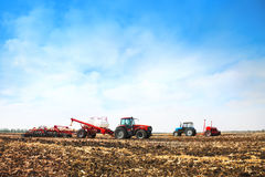 Tractors with tanks in the field. Agricultural machinery and farming. Royalty Free Stock Images