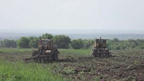 Tractors turn in the field. 4k. Flat pikture profile stock video footage