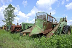Tractors and two row mounted corn picker Stock Images