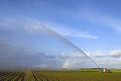 Tractors watering plants Stock Photos