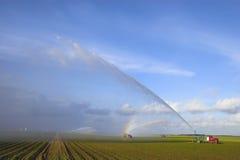 Tractors watering plants Stock Photos