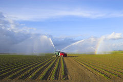 Tractors watering plants Royalty Free Stock Photos