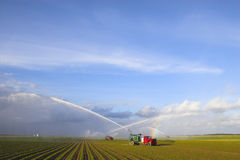 Tractors watering plants Stock Image