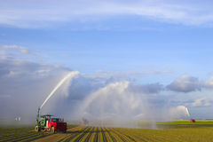 Tractors watering plants Stock Photography