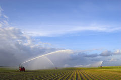 Tractors watering plants Royalty Free Stock Image