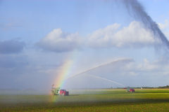 Tractors watering plants Stock Images
