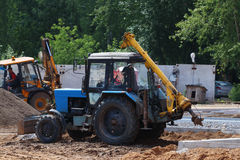 Tractors work on construction site with gravel and sand at s Stock Images