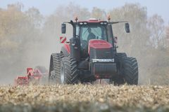 Tractors working on a corn field in czech republic royalty free stock photography