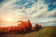 Tractors working in the field. Carpathians. Ukraine Europe Royalty Free Stock Photography