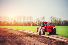 Tractors working in the field. Carpathians Ukraine. Europe Royalty Free Stock Photography