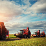 Tractors working in the field. Carpathians. Ukraine Europe Stock Photography