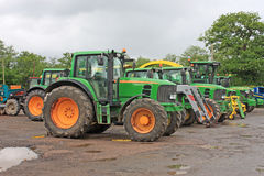 Tractors in a yard. Tractor standing in a farm yard royalty free stock photos