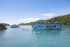 TRAD THAILAND - OCTOBER 29 : tourist boat floating over snorkeli Royalty Free Stock Photo