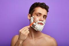 Tradaitional shaving of beard. close up photo stock images