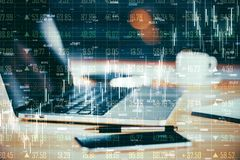 Trade and analytics concept. Close up of laptop and other items with forex chart hologram on blurry background. Trade and analytics concept. Double exposure royalty free illustration