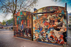 Trade booths on the flea market Waterlooplein, Amsterdam. AMSTERDAM, NETHERLANDS - MAY 5, 2016: Colorful trade booths on the flea market Waterlooplein, Amsterdam Royalty Free Stock Photo