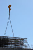Trade center construction. Construction cranes for carrying iron cages Stock Photo