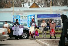 Trade in clothes from hands at the All-Russia Exhibition Centre. Illegal trade in clothes from hands before an entrance at the All-Russia Exhibition Centre Royalty Free Stock Photography