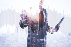 Trade concept. Businessman with document in hand drawing abstract business chart bars on bright city background. Trade concept. Double exposure Stock Photos