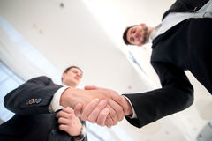 Trade confirmation. Two successful and confident businessman tal. King in office shaking hands with each other Royalty Free Stock Photo