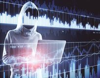 Trade and crime concept. Young hacker using laptop with digital forex chart. Trade and crime concept. Double exposure stock photos