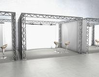 Trade exhibition stands. With chairs and screen at a grey floor Royalty Free Stock Photos
