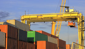 Trade and Export. Heavy crane moving and organizing export containers at the port Royalty Free Stock Photos