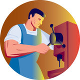 Trade factory worker drill press Royalty Free Stock Image