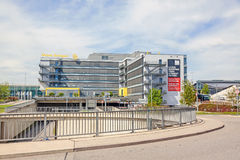 Trade fair Stuttgart, main building. Stuttgart, Germany - May 06, 2017: Trade fair Stuttgart - main building with logo Royalty Free Stock Photo