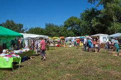 Trade in folk art at the fair in the summer glade. SHUSHENSKOE, Krasnoyarsk Territory, RF- July 11,2014: Trade in folk art at the fair in the summer glade for royalty free stock photo