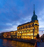 Trade house Esders and Scheefhals in evening illumination, embankment of river Moika, St. Petersburg, Russia. SAINT PETERSBURG, RUSSIA - MAY 1, 2017: Trade house Royalty Free Stock Image