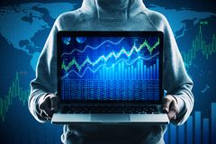 Trade and malware concept. Hacker holding laptop with forex chart on screen on creative map background. Trade and malware concept royalty free stock photography